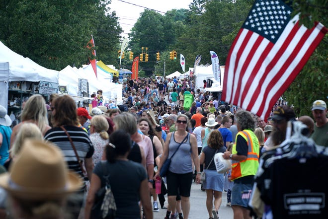 Milford Memories-goers stroll up and down South Main Street near Central Park in the afternoon of Aug. 9. 2019.