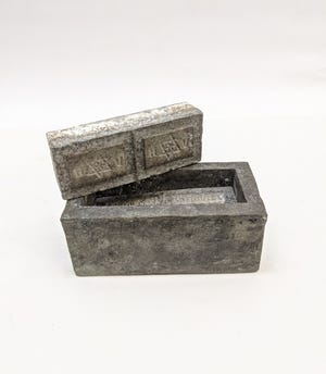 This stone soap mold from pre-WWII Poland features the Star of David and Hebrew markings.