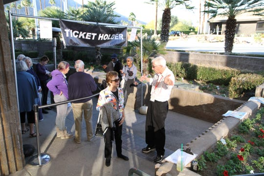 PSIFF volunteer Ron Collins gives directions to Jo Barbera.