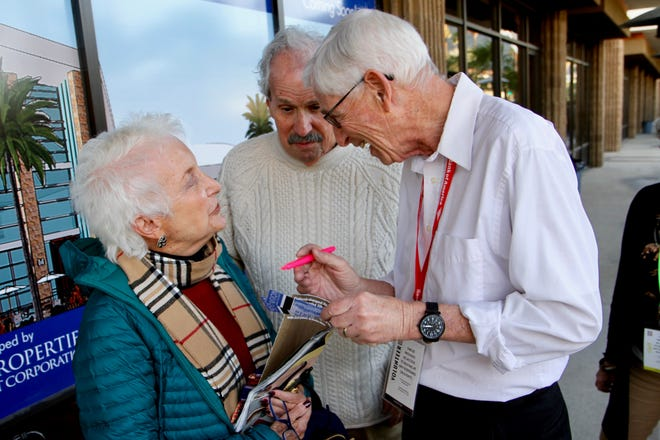 Ron Collins, volunteer for the Palm Springs International Film Festival, chats with Joan and Nick Behrmann as they wait to see a film at Regal Palm Springs.