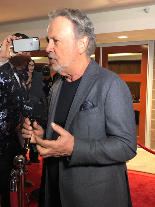 "Billy Crystal walks the red carpet at Palm Springs High School on Monday night before the showing of his movie ""Standing Up, Falling Down."""