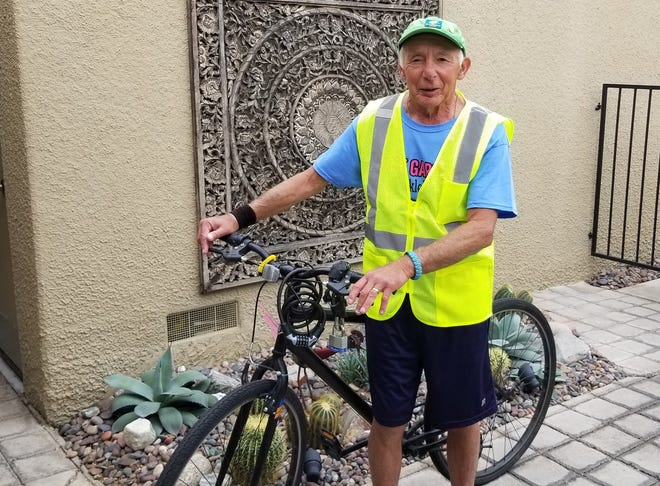Gary Hart models his safety vest from Volunteer Palm Springs' safety program, P.S Cares.