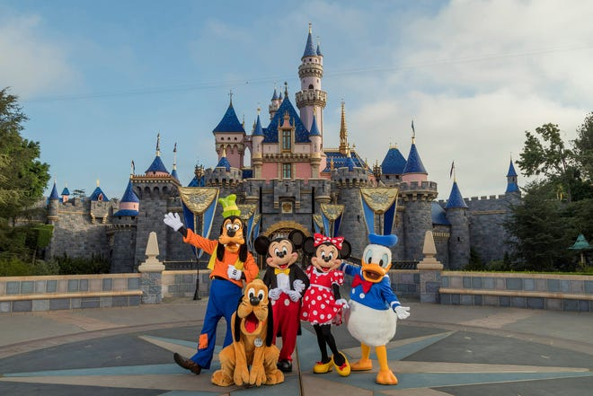 Standing in front of Sleeping Beauty Castle at Disneyland Park, Mickey Mouse, Minnie Mouse and their pals welcome visitors from all over the world.