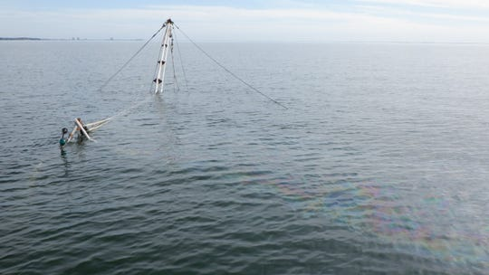 A shrimp boat sank in Pensacola Bay on Dec. 9, 2019, causing a noticeable sheen on the surface.