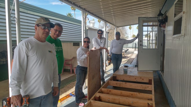 Volunteers with Phoenix nonprofit Rebuilding Together Valley of the Sun build and install custom wheelchair ramps at the homes of five older adults.