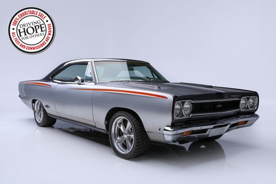 Chris Jacob will auction this 1968 Plymouth GTX custom coupe on Thursday, Jan. 16 at Barrett-Jackson in Scottsdale. The car features a custom paint scheme by Chip Foose. One-hundred percent of the sale will go toward the C4 Foundation.