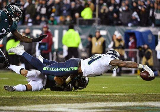 Seattle Seahawks wide receiver D.K. Metcalf (14) reaches for the endzone to score a touchdown as Philadelphia Eagles cornerback Avonte Maddox (29) attempts to make the tackle during the third quarter in a NFC Wild Card playoff football game at Lincoln Financial Field.