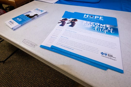 Flyers for Hope Not Handcuffs are set out on a table during an angel training session in the Yale Public Library. The program, which is an initiative of Families Against Narcotics, allows anyone who is sufferent from a drug or alcohol addiction to walk into any participating police station and request help without fear of arrest and regardless of insurance status.