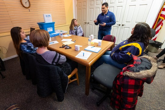Aaron Rubio, regional director for Families Against Narcotics, second from right, leads a Narcan training session Monday, Jan. 6, 2020, in the Yale Public LIbrary.