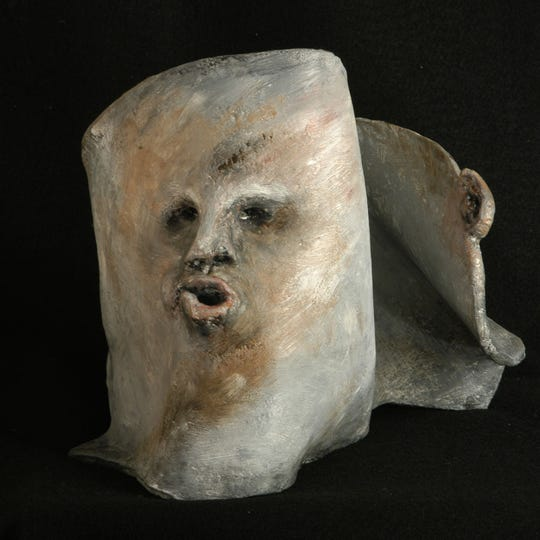 Tracy Leavitt exhibits her ceramic and encaustic sculpture, The Listener in Hot/Cold.