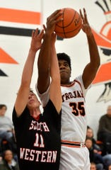 York Suburban's Anthony Brown, seen here at right in a file photo, had 16 points on Friday in the Trojans' win over Laurel Highlands.