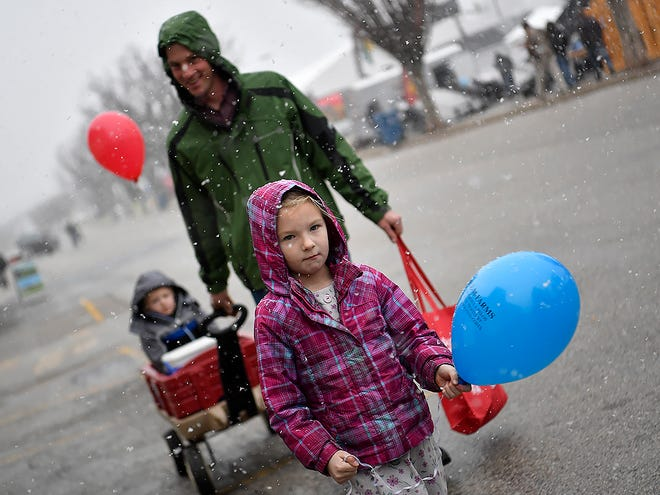 Kayleen Zeiset, 5 of East Earl, Lancaster County, leads her father Kerry, and brother Derek, 3, through the snow will attending the 1Keystone Farm Show at the York Expo Center, Tuesday, January 7, 2020.John A. Pavoncello photo