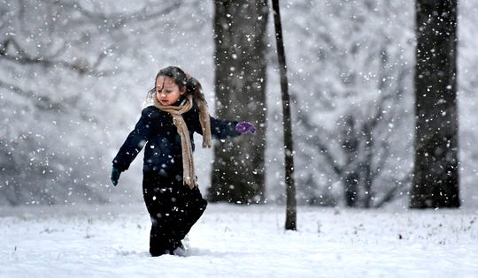 Alaina Brazeal, 5, of York City, leads the way while taking a snowy walk through Farquhar Park with her sister, mother and aunt Tuesday, Jan. 7, 2020. Snow fell throughout York County most of the afternoon. Bill Kalina photo