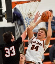 York Suburban's Aidan Hughley, seen here at right in a file photo, had 17 points on Friday in the Trojans' win over Laurel Highlands.
