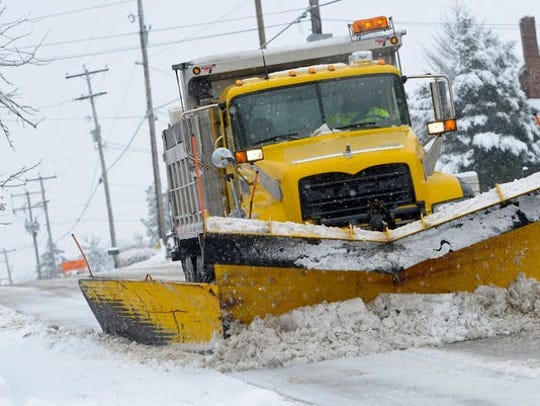 A PennDot snow plow clears the east bound lane of East Prospect Road in York Township, Monday February 3, 2014. York Dispatch File Photo (Photo: York Dispatch)