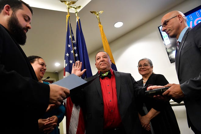 """Lou Rivera takes a ceremonial """"Oath of Office"""" administered by Pastor Joel Folkemer, left, at the start of the first York City Council meeting of the year, Monday, January 6, 2020. John A. Pavoncello photo"""