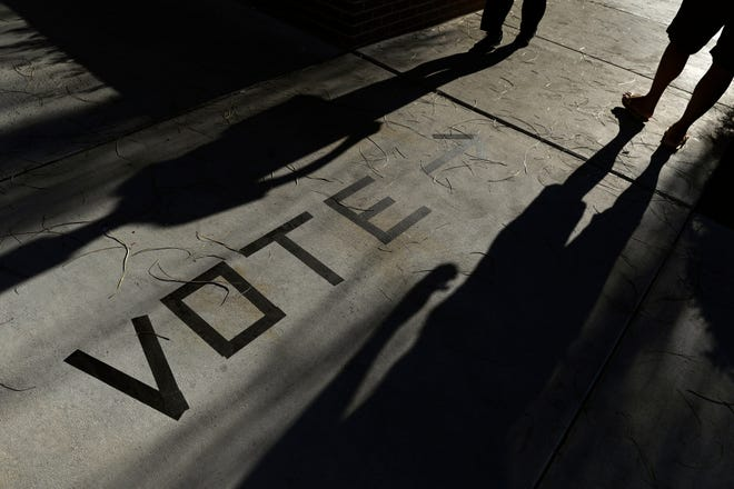 Voters head to the polls at the Enterprise Library in Las Vegas in 2018. A Nevada political group plans to revise and resubmit a proposed state constitutional amendment aimed at creating an appointed commission to redraw legislative and U.S. congressional voting districts.