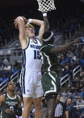 Nevada's Zane Meeks goes in for a dunk while taking on Colorado State.