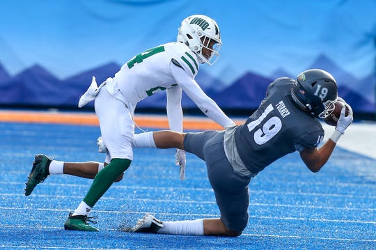 Jan 3, 2020; Boise, Idaho, USA; Nevada Wolf Pack wide receiver Cole Turner (19) makes a catch near the sidelines during the first half of the Famous Idaho Potato Bowl against the Ohio Bobcats  at Albertsons Stadium. Mandatory Credit: Brian Losness-USA TODAY Sports
