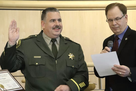 Shasta County Sheriff-Coroner Eric Magrini receives his oath office from Supervisor Leonard Moty in the Board of Supervisors chambers on Tuesday, Jan. 7, 2020.