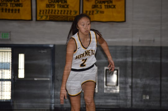 Enterprise senior guard Mianna Saechao dribbles the ball past halfcourt against Redding Christian at Manatowa Gymnasium on Jan. 2, 2020.