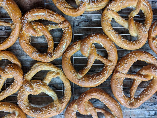 At her business Peace Love Pretzels Kelly Kiersky makes soft pretzels  of several different flavors and dipping sauces suited to each kind.