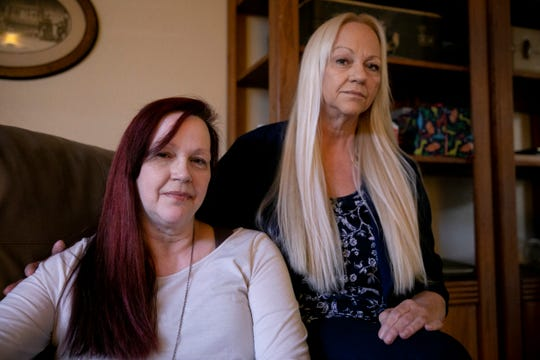 Sisters Catherine Hanson, left, and Linda Privatte in Hanson's home in Vacaville.