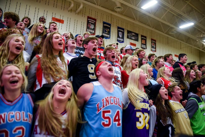 Lincoln High School students get fired up for their team during a boy's basketball game against Washington on Monday, Jan. 6, 2020 at the Washington High School.