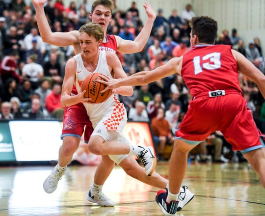 Washington's Kemmer Schramm (2) pushes past Lincoln defense during a boy's basketball game on Monday, Jan. 6, 2020 at the Washington High School.
