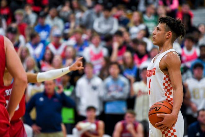 Washington's Eli Williams (5) prepares to shoot a free throw during a boy's basketball game against Lincoln on Monday, Jan. 6, 2020 at Washington High School.