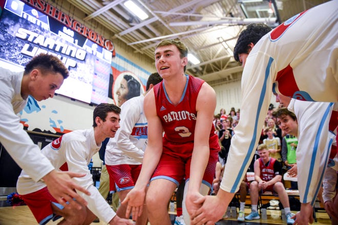 Lincoln's Max Burchill (3) is introduced before a boy's basketball game against Washington on Monday, Jan. 6, 2020 at Washington High School.