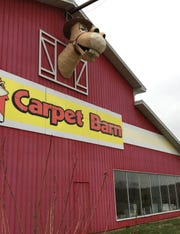 The Carpet Barn on Highway 13 opened in 1973 and closed in 2017.  The owners of the new business, Midwest Archery, took down Barney the horse (or is it a mule?) in December.