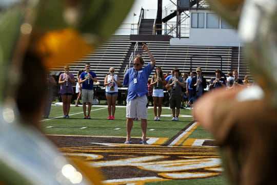 Kickapoo High School marching band director Troy Peterson directs his charges during marching band practice in this photo from the News-Leader archives.