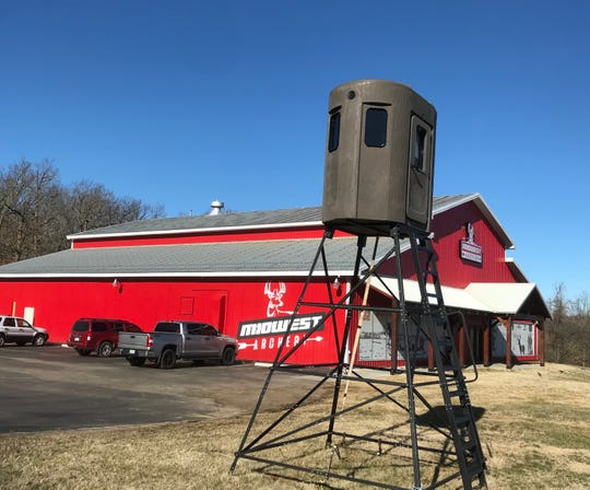 Midwest Archery on Highway 13 opened in 2018. The building -- painted a long time ago  to look like a barn -- had been the home of Carpet Barn for 44 years. It closed in 2017.  Barney the horse (or is it a mule?) was a familiar landmark on the front, facing Highway 13.
