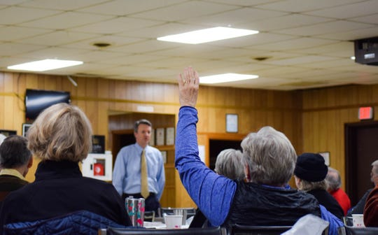 Cheri Moran raises her hand to ask Rep. Ben Cline a question during the congressman's Staunton town hall on Jan. 7, 2020.