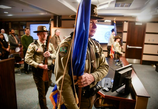 Stearn's County Sheriff's Department Honor Guard members present the colors before the start of the county board meeting Tuesday, Jan. 7, 2020, in St. Cloud.