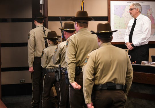 Stearn's County Sheriff's Department Honor Guard members leave the county board room after a short ceremony Tuesday, Jan. 7, 2020, in St. Cloud.