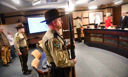 Stearn's County Sheriff's Department Honor Guard members stand at attention before the start of the county board meeting Tuesday, Jan. 7, 2020, in St. Cloud.
