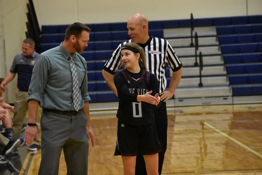 Pine View guard Sophie Jensen chats with coach Ben Luce.