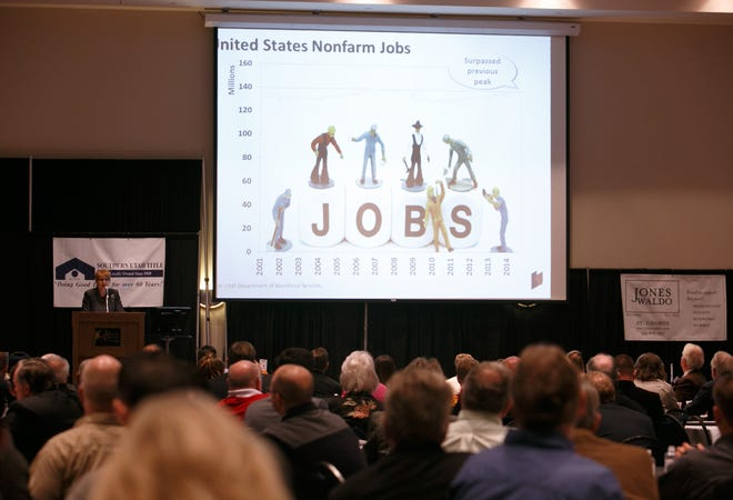 Lecia Langston provides a report on the state of the local economy during the What's Up Down South Economic Summit at the Dixie Center in St. George Thursday, Jan. 15, 2015.