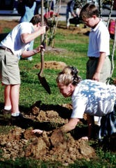 Twenty years ago, these students buried a time capsule and planted 12 trees at the (former) Academic Resource Center on Appleyard Drive.