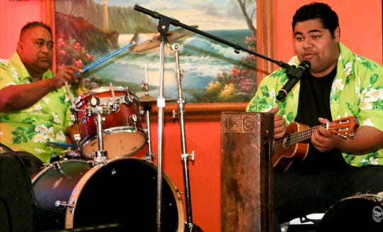 CARMEN SMYTH/SPECIAL TO THE STAR Sione Vainuku (left) along with his son Haatoa, are seen in this 2013 photo playing drums and ukulele in Tina's Port of Paradise band at the Puerto Nuevo Restaurant in Oxnard.