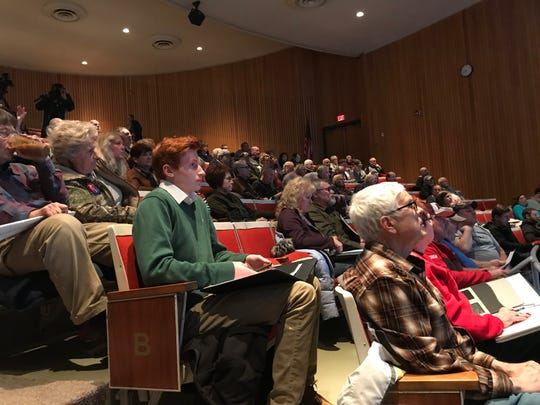 About 200 Wood County-area residents listen Monday evening to a panel discussion on water contamination.
