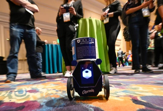 The Charmin RollBot' is demonstrated at Digital Experience a press preview event held at the Mandalay Bay Hotel in Las Vegas. The RollBot is a toilet paper delivery robot prototype.