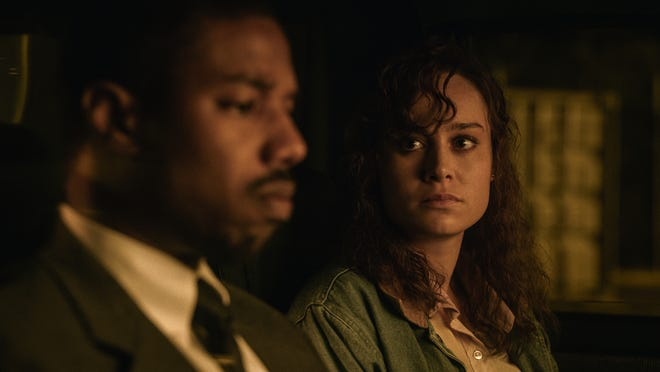 "Eva Ansley (Brie Larson, right) aids lawyer Bryan Stevenson (Michael B. Jordan) in ""Just Mercy."""