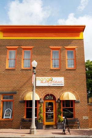 The outside of Mango Mangeaux features bright orange accents.