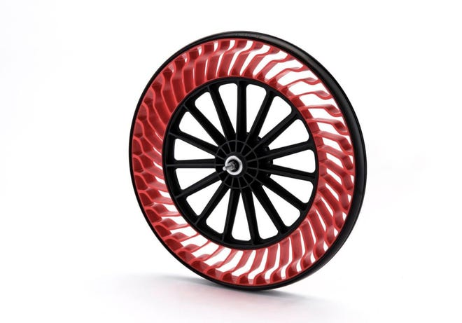 Bridgestone's advanced air-free concept tire uses recycled resin to recreate a puncture-proof wheel.