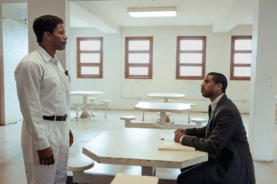"Death row inmate Walter McMillian (Jamie Foxx) meets with attorney Bryan Stevenson (Michael B. Jordan) in ""Just Mercy."""