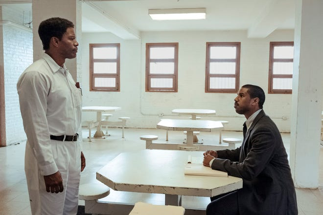 "Death row inmate Walter McMillian (Jamie Foxx) meets with attorney Bryan Stevenson (Michael B. Jordan) in ""Just Mercy."""