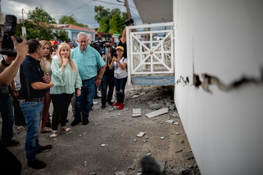 Governor Wanda Vazquez inspect an earthquake-damaged house in Guanica, Puerto Rico, Monday, Jan. 6, 2020.